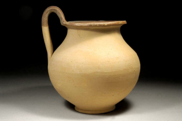 A Cypriot Late Bronze Jug of white Slip II Ware