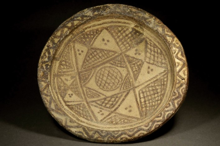A Mamluk Unglazed Red Painted Dish with Foot Ring
