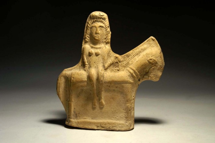 A Byzantine figurine of a nude queen riding a horse