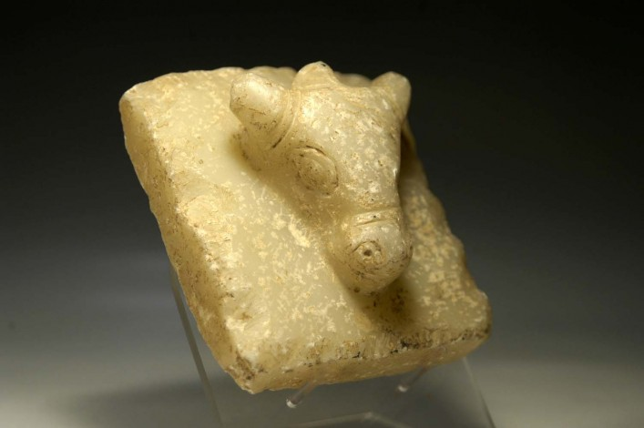 A Sabaean Alabaster Carved in High Relief with the Head of a Bull