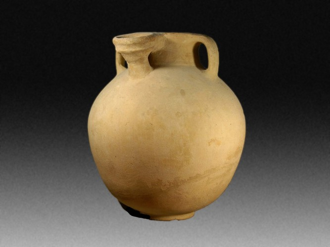 An Israelite Storage Jar with Three Handles and a Return Spout.
