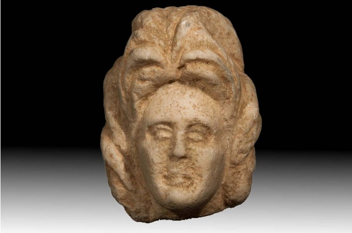 A Byzantine Marble Head of a Female Wearing a Wig