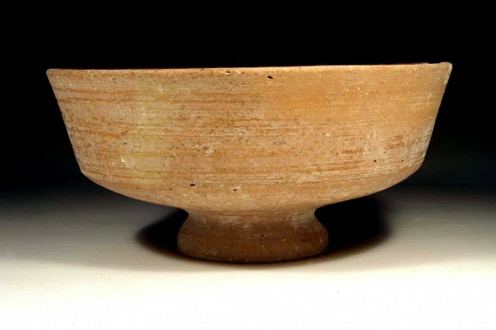 A Red Slip Smooth Israelite  Bowl with a Trumpet Base