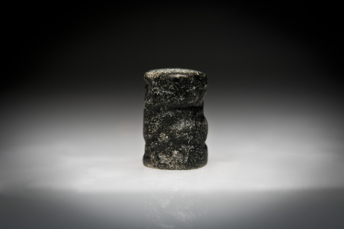 Pre-Dynastic Andesite Cylinder Seal With a Running Creature