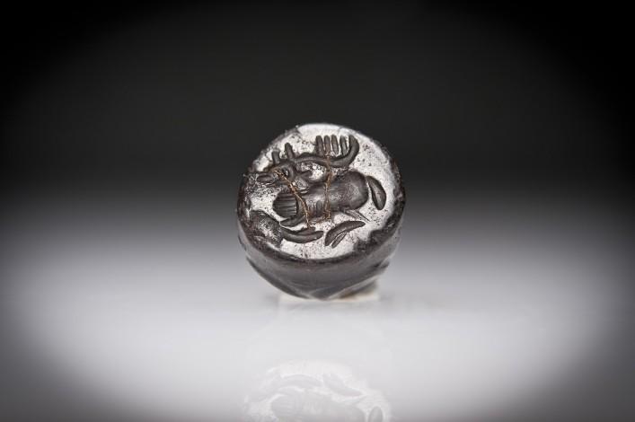 A Phoenician Hematite Seal of a Recumbent Deer