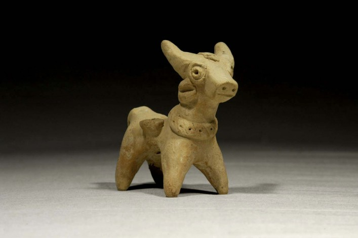 A Hittite Ceramic Animal with a Decorated Collar and Carrying Two Baskets