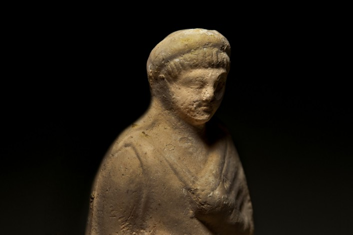 A Ceramic Figurine of a Draped Female