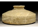 A Byzantine Flat Alabaster Flask with a Lid